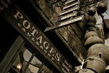 "◬ potage's / Potage's Cauldron Shop sells all types of cauldrons, displaying them in a stack outside the shop, under a sign which read: ""Cauldrons - All Sizes - Copper, Brass, Pewter, Silver - Self-Stirring - Collapsible."" It is owned by Madam Potage."