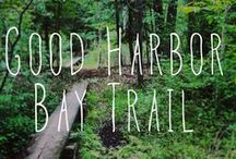 Good Harbor Bay Trail / #13 on our map and in our trail guide, Good Harbor Bay is a 2.8 mi easy hike and ski. It is a flat trail through some dunes, woods, and wetlands. Trailhead: off Lake Michigan Rd. ; take CR 669 north from M-22; follow Lake Michigan Rd. east   / by Sleeping Bear Dunes National Lakeshore
