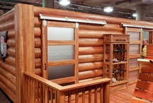 Custom Booth Design - Sightron / Sightron contacted MGP to design and build a custom log cabin @ SHOT Show in Las Vegas! Cabin is equipped with three dimensional log panels, etched glass sliding doors and standoff mounted logo. Another fun, exciting project to work on for MGP!
