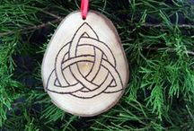 Handmade Holiday Ornaments / Handcrafted Wooden Ornaments  Beautiful handcrafted Christmas ornament, made from a slice of locally-harvested wood. After sanding, pyrography tools are used to burn a design onto the surface, and a coat of pure walnut oil is added as a finishing touch. The woods used will vary with availability, and generally be a mix of cherry, crepe myrtle, sweet gum, and more. Made in the USA. Sizes and shapes may vary as these are hand made items, but each ornament will be approximately the specified size.