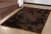 Shaggy Carpets / The shaggy carpets not only confine your feet with their smothering but also captivate your eyes as well. Display these carpets where everyone can observe the spectacular colors and feel the tickle as they walk over them.