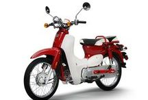 """SYM Symba 100 / Part of the attraction is certainly the classic retro design which is spot on. The SYM Symba 100 is a """"Cub"""" style motorcycle built to be stylish, fuel efficient and appealing.  For more information, please visit: http://alliancepowersports.com/models/Symba.html"""