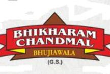 Bhikharam Chandmal Bhujiawala(BC Bhujiawala) / The business started 125 years back when an improverished man 'Tanuskhdas Agarwal' started making a snack product called Bhujia(Fried Product)in Bikaner(a small town in India). He started going around the streets to search for customers and serve them hot fried snacks. He than set up a small shop and rapidly 'Bhujia' became the most famous snack product name in that small town.