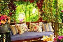 Outdoors / Garden, porch, cottage, patio, yard, flowers, swing, fence, gazebo.