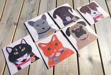 Hand Illustrated Dog and Cat Cards / Cheeky Chops features six adorable and characterful cats and dogs on a series of FSC certifed square greeting cards.  We all love our pets because they have personality and attitude & because we can never really properly work out exactly what they might be thinking.  Our animal illustrations start life as meticulously hand-cut paper collages – very sharp implements & magnifying glasses are involved to make sure each creature is full of personality, expression & attitude.
