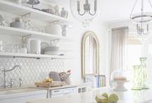 Kitchens / I love white kitchens.  White cabinets, white countertops, white walls and (usually) dark floors.  :)   With touches of bright color.