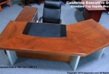 """California Executive Desk - Brown Model / We just sold out of this item!!!!! This is an ideal CEO desk. This one of a kind, 9'-6"""" wide desk with our standard 2 level desktop is made with exotic African Sapeli Pommele wood in a medium brown color. A truly modern wood desk.            *******************************           We currently only have 1 left in stock with a right side return"""