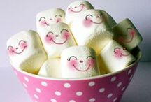 Sweet Candy Marshmallow / A sugar candy that, in its modern form, typically consists of sugar, whipped to a spongy consistency, molded into small cylindrical pieces, and coated with corn starch. Some marshmallow recipes call for eggs.