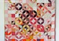"MINI QUILTS / Mini quilts go on your wall, in a frame, on a table, or anywhere else you might find needing a quilt.  They are small, usually under 24"".  Every sewing room needs a wall of minis."