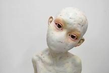 identity: frocks, masks, dolls