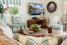 A Hawaiian Escape | Kathy Ann Abell Interiors / Combining rustic elm furniture with the vibrant blues, corals and greens created a current coastal vibe. Because this home will double as a vacation rental, we wanted each room to feel welcoming and have its own unique personality. In a Hawaiian paradise like Princeville, it's imperative that the outdoor living areas are not an afterthought. In order to take full advantage of the home's tropical surroundings we created three seating areas on the lanai.