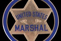 Badges / Police badges, Marshal badges, Ranger badges, Sheriff badges. All sorts of badges from past and future auctions.
