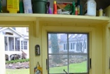 Potting Shed / Okay, it's a girl cave.  Rakes rather than recliners.  No big screen television, but a recycled CD player shaped like a VW Beetle provides musical ambience.  How about a mini fridge and a ceiling fan?  It can get hot out there!