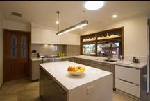 Craigieburn Kitchen / Designer: Suzzanne Blades Location: Craigieburn Photography by Yvonne Menegol The original kitchen in this house felt confined and dark, was short on storage and completely stuck in the 80s! Our designer, Suzzanne Blades, changed the footprint of the kitchen to open it up and provide more storage. Removing the oven tower makes the space feel larger and using a lighter colour on the overhead cabinets makes the space feel softer. All in all, a clever and practical change to the space.