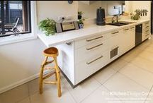 Ivanhoe Kitchen 2 / Designer: Haydn Bradbury Photography by Yvonne Menegol Nestled into the beautiful suburb of Ivanhoe sits this cozy unit; home to clients John & Aish. What was a tunnel-like kitchen space has now been modestly opened up to let in light and conversation. Aish particularly loves how maintaining some walls has meant you can't see the kitchen mess while in the family room and the clever little breakfast bar at the end is the perfect place for working on her laptop while enjoying the sunshine.