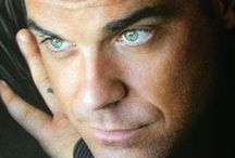 Robbie Williams - UK / I Love a cheeky UK man.  This one isn't even cheeky anymore, he is just trouble ;-)