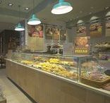 Bagga, Lisbon / BAGGA, SONAE's new insignia for cafeteria and pastry segments, is furnished with FUTURO counters range from JORDAO. This range answers to the needs of daily bread consumption and to light meals service, providing an optimal food display.