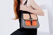 Designed by Jonathan Saunders / We've collaborated with leading British fashion designer, Jonathan Saunders. His unique skill for combining often-unusual colour combinations and innovative print design goes hand in hand with our love affair with bold hues and vibrant prints. Taking reference from our signature styles, the result is a striking capsule collection of graphic leather bags and wallets.