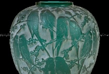 RENÉ JULES LALIQUE -  Art Glass / René Jules Lalique (6 April 1860, Ay, Marne – 5 May 1945, Paris) was a French glass designer known for his creations of perfume bottles, vases, jewellery, chandeliers, clocks and automobile hood ornaments. He was born in the French village of Ay on 6 April 1860 and died 5 May 1945. He started a glassware firm, named after himself, which still remains successful.