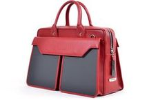 Tre Tasche Red / Tre Tasche Large Tote is beautifully crafted in leather and soft carbon fiber in an asymmetrical modern design that allows for elegance and function for your business needs.