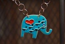 Elephant Jewelry / Unique handcrafted jewelry incorporating silver, gold, enamel, and gemstones, to create elephant themed jewelry in the forms of necklaces and pendants.