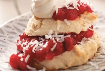 Shortcakes  / Shortcake is a sweet biscuit made with sliced fruits that are mixed with sugar and allowed to sit an hour or so, until the fruit have surrendered a great deal of their juices. The shortcakes are split and the bottoms are covered with a layer of fruit, juice, and whipped cream, typically flavored with sugar and vanilla. The top is replaced, and more fruit and whipped cream are added onto the top.  / by Brenda Law