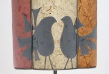 Sarah Walker - half lampshades / Half shades are ideal for narrow spaces - bookshelves, bedside tables, mantelpieces and console tables.  Many can also be used as wall lights.  The lampshades here are made from layered, stitched and cut plant-fibre papers.  They can be made to order in a variety of colours. www.artshades.co.uk