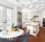 A Kitchen Fit for a Queen / This month's moodboard is brought to you by House of Bohn! Their gorgeous white kitchen showcases Metrie's Fashion Forward Collection with a showstopping coffered ceiling. But there's more inspiration to draw from this design: the bright but warm palette, the use of natural materials, and the fun juxtaposition of traditional and mid-century design. Happy pinning!