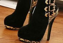 Shoe Obsession!! / Sky high-heel shoes I wish I could wear. / by Marty Lawal