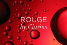 ROUGE BY CLARINS / Clarins is symbolised by the colour red. Red is for love and passion and ruby red lips. Red is the colour of delight, and also the colour of a crisp, juicy apple. It evokes fascination, excitement, and intoxication. RED.