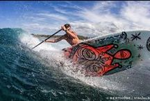 SUP Surfing / Standup Paddle or SUP is many things to many people. SUP Surfing waves is just one aspect. If you love to slide across these wonderful creations you will not find any better vehicle for playing in the ocean.
