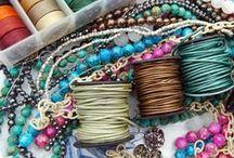 She's making jewelry now! / by Debbie Gnewikow