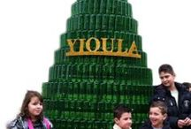 YIOULA & Christmas Tree 2013 / A large Christmas tree made of 700 glass bottles   For those looking for a way to make this your greenest holiday season yet, take a hint from the craftsmen of YIOULA Glassworks in the Athens / Aegaleo factory that decided to create the 2013 Christmas tree out of wine glass bottles.  Featured near the company's outside entrance is a perfectly formed tree, almost 3 meter high, made of 700 green wine bottles created by workers in the factory.