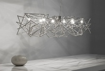 ETOILE / A CELESTIAL SUSPENSION OF INTERWOVEN NICKEL-PLATED METAL SHAFTS, ETOILE TWINKLES IN ALL DIRECTIONS CREATING A GENTLE PLAY OF LIGHT AND SHADOW FOR ANY SPACE. DESIGN CHRISTIAN LAVA.