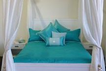 Suzette's Collection Designer Bed Linen / Designer bed linen with an emphasis on originality, tailoring and durability, innovative designs such as boxed pillows and dual-fabric duvet covers. Designs cater to a range of tastes.