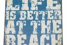 By the Beach / Life is better by the beach! Fresh blues, driftwood and coastal vibes... our range of beach home decor has it all! If you are looking to bring the beach into your home, no matter how far you live from the sea, our beach themed signs and decor will make any room feel like the beach!