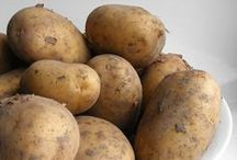 Potatoes / Potatoes you will eat in within 4-5 weeks will store well in the 40-60 degree range.  Keep them in a paper bag to keep out the light.  Light is what will turn potatoes green.  You have probably heard that eating a green potato is toxic.  More on that here: http://extension.psu.edu/food/preservation/faq/green-potatoes  For potatoes you want to store for longer periods, cold temperatures become more important.  Use your refrigerator or a cold area in your garage, attic or basement for this.