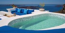 The Iconic Suite / Our most lavish accommodation, The Iconic Suite captures the true class, grace and power of Santorini, icon of the Greek isles. The outsized living area, elegant bedroom and quixotic grotto pool open to generous terrace space and dramatic views overlooking the azure blue waters below.