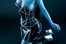 ~ Shock and Awe ~ / Sexy and shocking; futuristic, cyber-punk, latex, fiberoptic, cyborg, cybergoth, and post apocalyptic fashion ~ White, Blue, Purple, Black, & Silver