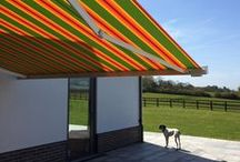 Patio Awnings / Providing a stylish roof over the terrace, our retractable patio awnings and canopies keep you, your family and friends cool in the sun, protected from harmful UV rays and bright light, along with providing much needed shelter from those occasional rain showers, whilst adding an eye catching new dimension to the façade.
