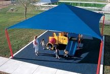 Cooltoppers / Keeping play cool. CoolToppers® Shade Systems can be attached to Playboosters or used as a standalone product. Cooltoppers are designed to block up to 90 percent of the sun's harmful UV rays and keep playground temperatures up to 30 degrees cooler.