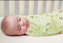 Swaddling / Our award-winning SwaddleMe wraps help keep babies sleeping safely on their backs while replacing loose blankets in the crib.  It also recreates the snugness of the womb, so babies startle less and stay asleep longer.  / by Summer Infant