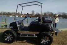 Wildest Club Car / Custom Club Car golf cart, 10 inch long travel lift kit, chrome coil over shocks, black metallic with purple pearl paint, stainless steel roll cage and rear seat kit, custom made seats with black roll and pleats with purple snake skin, Zenco header with dual exhaust, Jakes shifter, front disk brakes.   If you can dream it we can make your dreams come true.