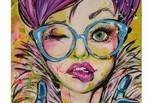 LUCIE-EMMANUELLE / Née avec la pop culture des années 80 en Ardèche, LUCIE-EMMANUELLE est une artiste peintre basée dans les Alpes-Maritimes.  Ses toiles sont le reflet de sa passion pour les personnages, qu'elle griffonnait de manière viscérale sur des coins de table depuis son adolescence.  Elle propose aujourd'hui sa représentation personnelle de la variété des émotions et met en avant « La Femme » dans un style parfois juvénile, un brin provoc', nuancé d'une part sombre mais toujours haut en couleur.