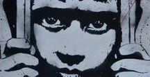 TED NOMAD / Ted Nomad est né sur la route.  Il a laissé des stigmates anonymes de ville en ville, forgeant son univers, peuplé des portraits de ses rencontres. Depuis 2001 il développe la technique du pochoir. Sa peinture est instinctive, jetée, comme une nécessité, une urgence.  Il puise son inspiration dans l'être humain, ses émotions, dans ses figures anonymes ou célèbres, ses rencontres. Une inspiration puisée dans l'actualité ou le quotidien de tous.