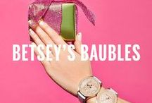 Betsey's Baubles / Betsey Johnson's collection of jewelry including earrings, rings, bracelets, necklaces, and watches.