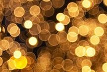 glisten, glimmer, sparkle, shimmer / glisten = a lustrous sparkling light reflecting on a surface .. ..  glimmer = a faint or wavering light; gleam .. .. sparkle = emitting little sparks, as fire or glittering flashes of light .. .. shimmer = shine with or reflect a soft, subdued, tremulous light