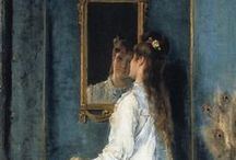 She Looks Into Mirror in Art