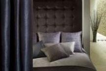 Ambience / Collection photograph of our fabrics for soft furnishings - An intriguing textured range of distinctive, wide width plains. Tonal and timeless weaves convey depth and understated opulence in intimate and diffused tones.