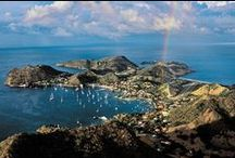 """Les Saintes / Les Saintes is formed by nine unspoiled islands, two of which are inhabited. Terre de Haut with its bistro lined streets and the turquoise waters of its bay, a member of the Most Beautiful Bays in the World Club. And Terre de Bas also has plenty to offer: the golden sand of Grande-Anse beach is well worth the detour. The culinary specialties are the products of passion: do not leave without having savoured the traditional """"Tourment d'Amour"""" cake. Perfect for romantics."""